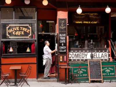 Going to the Comedy Cellar, one of the quirky things to do in NYC.